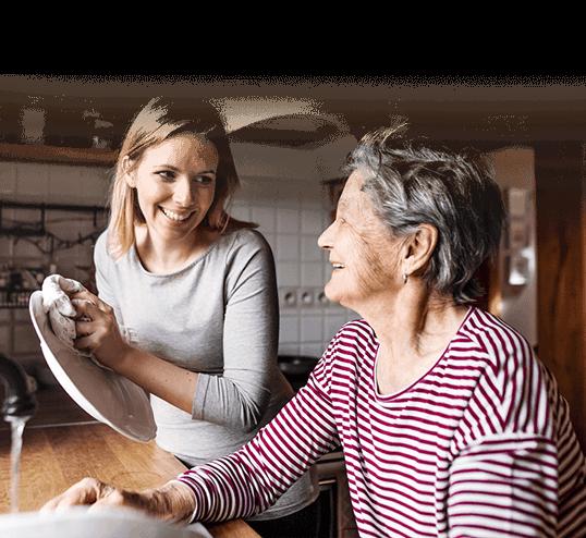 Nurse and senior woman washing dishes