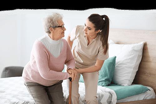 Nurse Assisting Old Woman