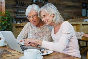Senior women looking on laptop