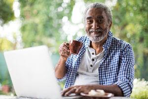 Senior man having coffee smiling