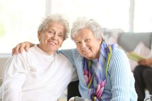 to senior women hugging while discussing fort worth texas senior living activities