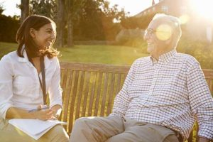Man discussing senior living options with woman.