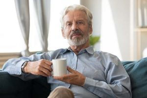 Man enjoys cup of coffee in senior independent living.