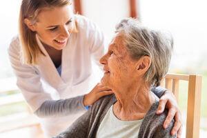 nurse helping a resident get settled in skilled nursing senior living homes