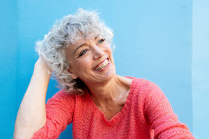 Woman smiling because of residential senior living options.