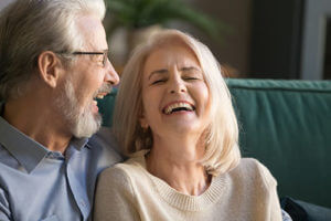 happy woman learning about senior living housekeeping services