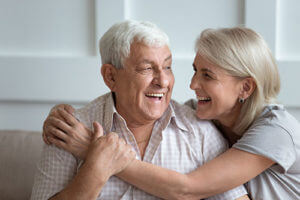 happy couple participating in senior living community activities