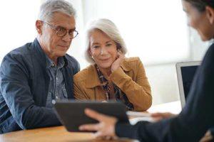 Seniors discuss exclusive senior living programs at Discovery Village.