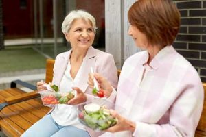 friends enjoying lunch through personal care living homes
