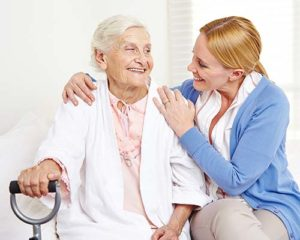 Woman receiving help at senior assisted living at Discovery Village.