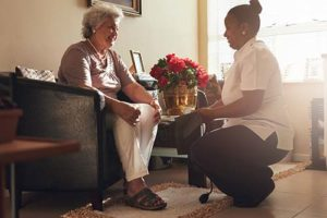 Senior woman receives help at senior independent living at Discovery Village.