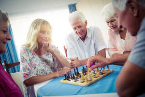 Group of People Playing Chess