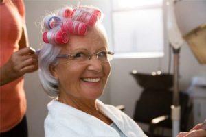 woman getting hair done through senior living amenities