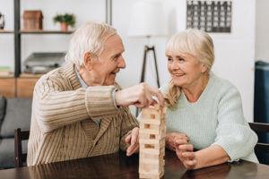 Seniors play games during senior living programs.