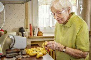 woman peeling potatoes in our senior independent living homes